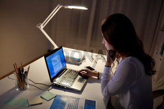 businesswoman with laptop at night office