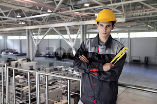 Worker with wrench at factory