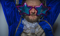 Disco, Man with beard dressed like a pirate and ridiculous glasses, funny and humorous, costume party