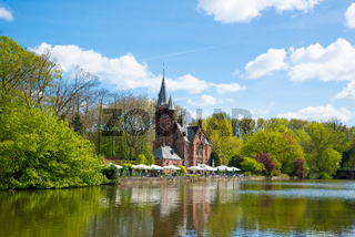 Minnewater castle at the Lake of Love in Bruges, Belgium.