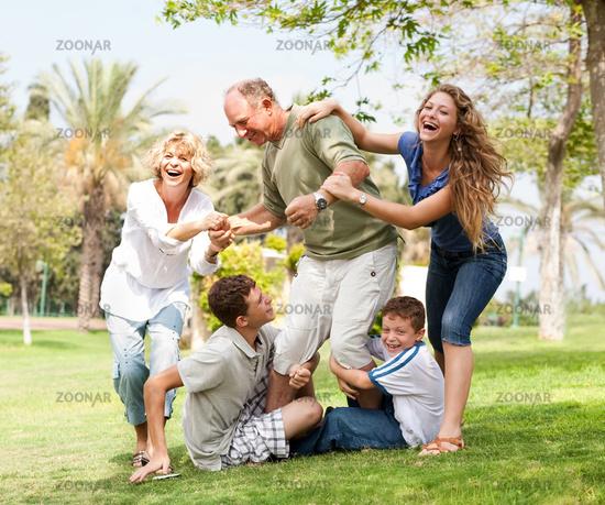 Grandparents having picnic with grandchildren
