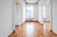 renovated old building room, flat with stucco ceiling and parquet floor