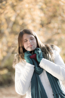 Winter fashion - woman in park