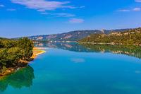 Smooth green water of Lake Sainte-Croix-du-Verdon