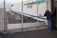 airport Frankfurt-Hahn with man looking for a airplane, Rhineland-Palatinate, Germany, Europe