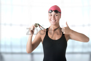 Female Swimmer Holding Medal
