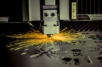CNC Laser cutting of metal, modern industrial technology. .