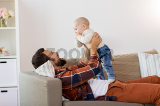 happy father with little baby boy at home