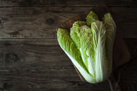 Chinese cabbage on a cutting board on old boards on right