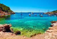 Sailboats at Cala Salada lagoon. Idyllic scenery. Ibiza
