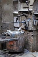 Aluminum flows into a crucible
