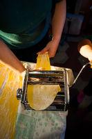 preparation of fresh pasta homemade tagliatelle with the machine by hand