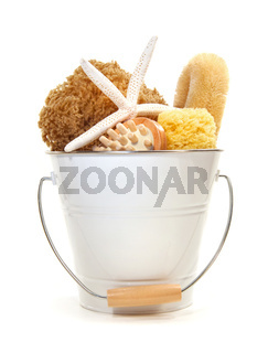 White bucket filled with sponges, brushes and starfish