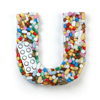 Letter U. Set of alphabet of medicine pills, capsules, tablets and blisters isolated on white.
