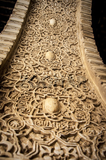 Arabic decoration in plaster. Alhambra of Granada. Spain