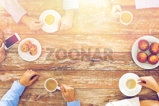 close up of business team drinking coffee on lunch