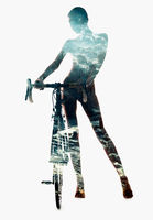 Silhouette of a woman with bicycle combined with a snow-covered countryside landscape. Double exposure, isolated on a white background