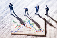 Businessmen looking at market charts