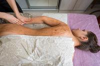 Top view of girl getting procedure in spa salon