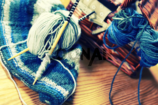 toned wool and knitting needles