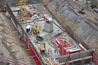 Construction site with exavation, machinery, workers