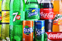 Bottles of global soft drink brands including products of Coca Cola Company and Pepsico