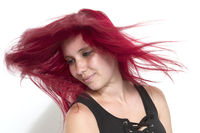 Flying hair at a red-haired woman