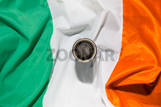 St Patrick day with a pint of black beer and irish flag