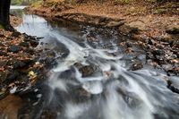 Water Flowing Down the Rapids of a Stream