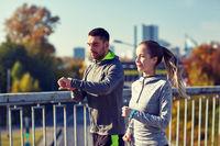 couple running over city highway bridge