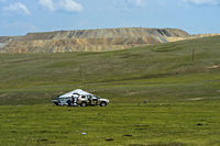 Family arriving by car at its yurt, Mongolia