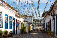 Typical cobblestone street with colonial buildings in historic town Paraty on the time of Carnival, Brazil