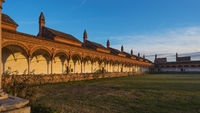 Grand Cloister of the Pavia Carthusian monastery at sunset
