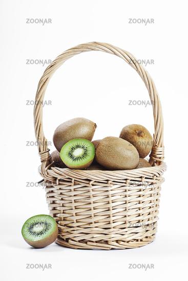 wicker basket full of fresh juicy kiwi