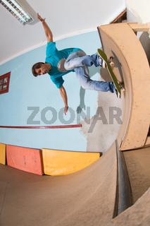 Skateboarder performing a backside turn