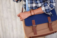 close up of hipster man with stylish shoulder bag