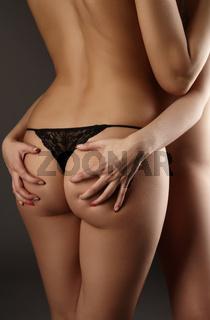Erotica. Woman touching her girlfriend#39;s ass