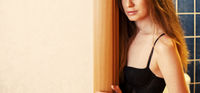 Girl Leaning On Wall In Door