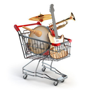 Shopping cart with music instruments isolated on white. Guitar, trumpet and drum.