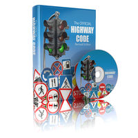 Highway code book and disk.  Book of traffic rules and law with traffic road sign and traffic light. Preparation for exam or driving test concept.