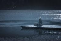 Girl on wooden pier on lake Bled