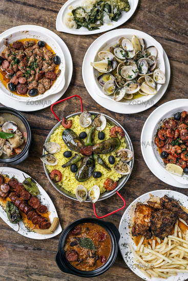 mixed portuguese traditional rustic tapas food selection on wood table
