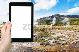 tourist photographs Haukadalur geyser valley