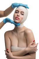 Girl her head bandaged at medical examination