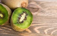 Whole Food Fruit Green Kiwi Halves Seeds Cutting Board