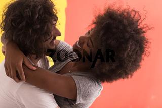 Young happy multiethnic couple hugging