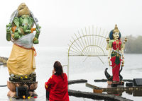 Woman pray in front of hindu Deity