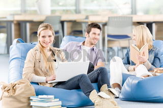 Group of high-school students with books sitting
