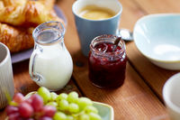 jar with jam on wooden table at breakfast