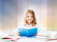 happy smiling student girl reading book